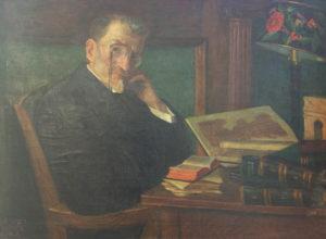 ציור של אליעזר בן יהודה רכון על המכתבה שלו